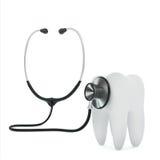 Estetoscopio examing el diente Fotografía de archivo libre de regalías