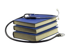 Estetoscopio y libros Fotos de archivo libres de regalías