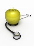 Estetoscopio y manzana Fotografía de archivo