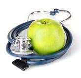 Estetoscopio y manzana médicos Imagen de archivo libre de regalías