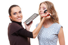 Esthetician applying eyeshadow Stock Photos