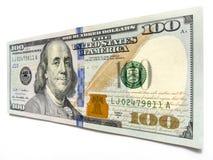 Esticando sua notas de dólar nova do orçamento cem com Ben Franklin Fotografia de Stock Royalty Free