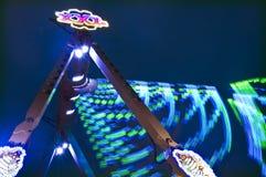 Estilingue justo do campo de jogos na noite Imagem de Stock