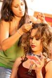 Estilista do cabelo no jogo Fotografia de Stock