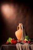 Estilo de vida flamengo no fundo marrom Fotografia de Stock Royalty Free