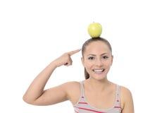 Estilo de vida saudável - maçã de mãos da mulher da aptidão fotografia de stock royalty free