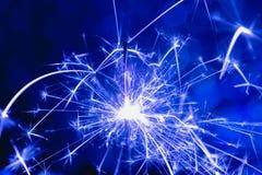 Estilo del azul del color La Navidad y el Año Nuevo van de fiesta la bengala con el fondo circular abstracto del bokeh Imagenes de archivo