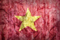 Estilo do Grunge da bandeira de Vietname em uma parede de tijolo Foto de Stock Royalty Free