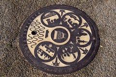 Estilo japonês do tampão do dreno na cidade de Nagoya fotografia de stock