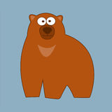 Estilo marrón grande de la historieta del oso grizzly en un fondo azul Imagen de archivo