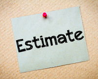 Estimate. Message. Recycled paper note pinned on cork board. Concept Image stock photography