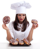 Estimating cake female chef Stock Photo
