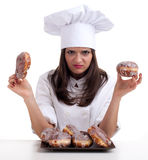 Estimating cake female chef with donut Stock Images
