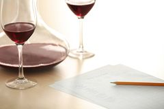 Estimating red wine in wineglass. At tasting royalty free stock images