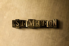 ESTIMATION - close-up of grungy vintage typeset word on metal backdrop Royalty Free Stock Images