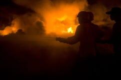 ESTINZIONE DI INCENDIO INDONESIANA Fotografie Stock Libere da Diritti