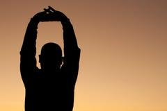 Estiramento do nascer do sol Fotografia de Stock Royalty Free