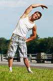 Estirar ejercicios antes de deporte Fotografía de archivo libre de regalías