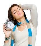 Estirar a la muchacha con el despertador Fotografía de archivo