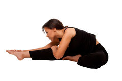 Estirar los músculos antes de entrenamiento Imagen de archivo libre de regalías