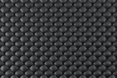 Estofamento de couro Sofa Background Sofá luxuoso preto da decoração Textura de couro preta elegante com os botões para o teste p Imagens de Stock