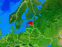 Estonia on Earth with borders. Estonia from space on model of planet Earth with country borders and very detailed planet surface. 3D illustration. Elements of royalty free stock image