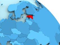 Estonia on blue globe. Estonia highlighted on blue 3D model of political globe. 3D illustration Stock Photography