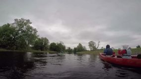 Estonia, May 2015, US Soldiers River Trip With. US soldiers paddles in a small boat with children along a river stock video footage