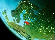 Estonia in red in the evening. Country of Estonia in red on planet Earth in the evening. 3D illustration. Elements of this image furnished by NASA Stock Images