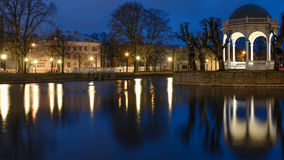 Estonia, Tallinn, Kadriorg part at night. Night in Kadriorg park. Estonia, Tallinn. Reflection in still water and street lights. Blue sky background Royalty Free Stock Photos