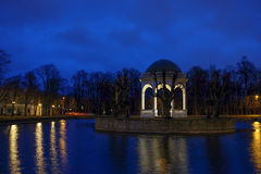Estonia, Tallinn, Kadriorg part at night. Night in Kadriorg park. Estonia, Tallinn. Reflection in still water and street lights. Blue sky background Stock Photo