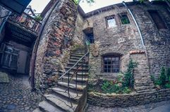 Estonia, Tallinn - May 17, 2016: Old town street. distortion perspective fisheye lens stock photo