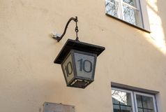 Estonia Tallinn old street lamp with house number stock images