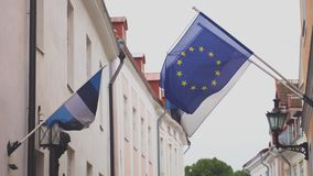 Estonian and Europe union flags waving. stock video
