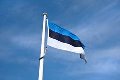 Estonian flag in blue sky. Royalty Free Stock Photography
