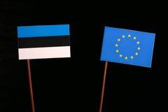 Estonian flag with European Union EU flag isolated on black. Background Royalty Free Stock Image