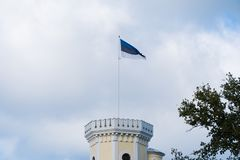 The Estonian flag flies on the tower royalty free stock photography