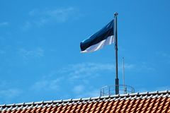 Estonian flag on Tall Hermann Tower in Old Town of Tallinn, Estonia Royalty Free Stock Photography