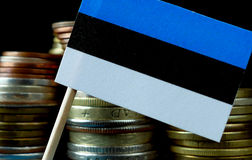 Estonian flag waving with stack of money coins Stock Image