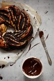 Estonian Kringle. Brioche with poppy and chocolate. Wreath. Baking, national pastries. Babka. Yeast baked with poppy seeds in the form of a wreath stock photos