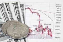 Estoques e dinheiro Imagem de Stock