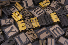 Estore in wooden typeset. The word Estore surrounded by random typeset Stock Photo