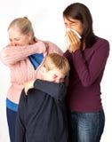 Estornudo/que tose de tres personas Fotografía de archivo libre de regalías