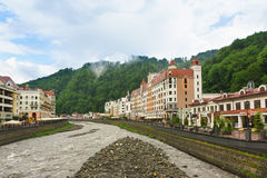 Estosadok, Sochi, Russia - June 10.2017: Hotels and shopping arcades along the Mzymta river in the ski resort Rosa Khutor Stock Images