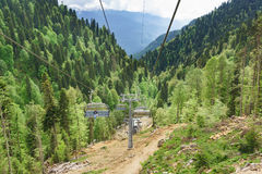 Estosadok, Sochi, Russia - June 10.2017: a Lone passenger on the cable car to the ski resort. `Rosa Khutor` in the Caucasus mountains. Cloudy day in early Royalty Free Stock Photo