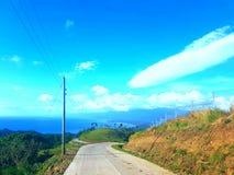 Estrada à cidade Leyte de Baybay do pico de Lintaon Foto de Stock Royalty Free