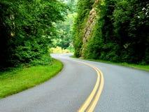 Estrada à luz solar Fotografia de Stock Royalty Free