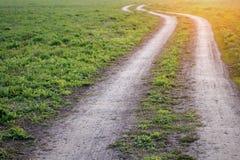 Estrada à terra na luz solar Fotografia de Stock Royalty Free