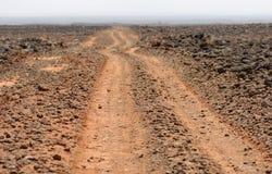 Estrada áspera selvagem do deserto Imagens de Stock