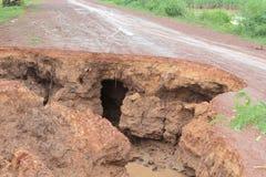 A estrada é danificada Imagens de Stock